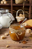 Homemade caramel sauce on wooden table Royalty Free Stock Photography