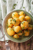 Homemade caramelized new potatoes close-up on a plate. vertical Stock Image