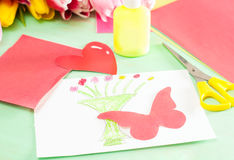 Homemade card with butterfly on wooden background Royalty Free Stock Photos