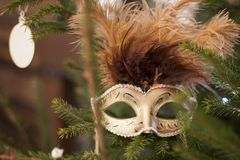 Homemade carnival mask on the Christmas tree in the new year Royalty Free Stock Photography