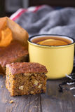 Homemade carrot and banana cake, a cup of tea with lemon Stock Photo