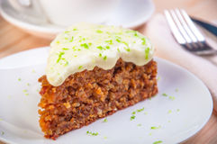 Homemade carrot cake dessert on the white plate Stock Photography