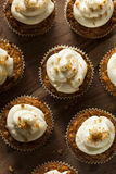 Homemade Carrot Cupcakes with Cream Cheese Frosting Royalty Free Stock Images