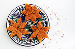 Homemade carrot halvah, traditional indian sweet, on blue plate Royalty Free Stock Image