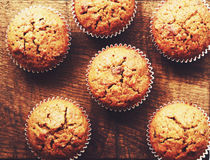 Homemade carrot muffins on brown wooden background Royalty Free Stock Photos