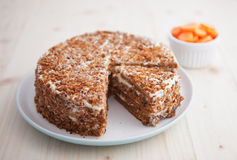 Homemade carrot and walnut cake on a wooden table Royalty Free Stock Photos