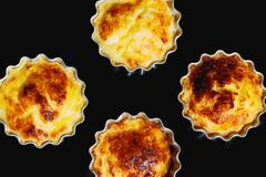 Homemade casseroles, cupcakes shaped, black background