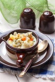 Homemade cauliflower soup in a brown bowl. Stock Photography