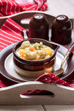 Homemade cauliflower soup in a brown bowl. Royalty Free Stock Images