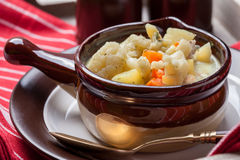 Homemade cauliflower soup in a brown bowl. Royalty Free Stock Image