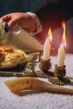 Homemade challah on Shabbat. A man breaks Saturday& x27;s festive bread Homemade challah on Shabbat Royalty Free Stock Photography
