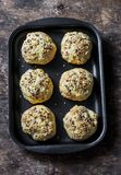 Homemade cheese buns on a baking tray on a wooden background royalty free stock photography