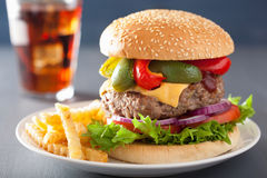 Homemade cheese burger with peppers tomato onion Royalty Free Stock Photography