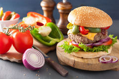 Homemade cheese burger with peppers tomato onion Royalty Free Stock Photo