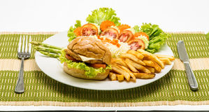 Homemade cheese chicken burger with fresh salad on plate. Stock Photo