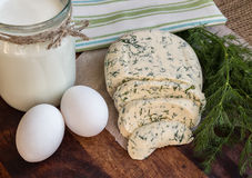 Homemade cheese with dill, milk and eggs. On the wooden background Royalty Free Stock Images