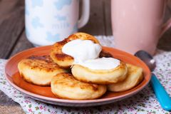 Homemade cheese pancakes on a plate. Homemade cheese pancak on a plate Stock Photo