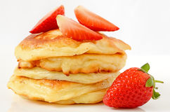 Homemade cheese pancakes and strawberries Stock Photography