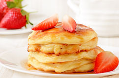Homemade cheese pancakes and strawberries Stock Image