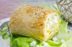 Homemade cheese pie with green salad on a tray Royalty Free Stock Image