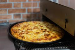 Homemade cheese pizza on grill. Stock Photo