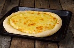 Homemade cheese pizza, Heorgian food - Hachapuri on wooden background. Selective focus Stock Photos