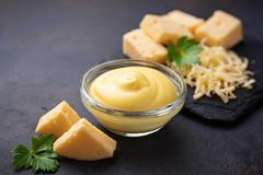 Homemade cheese sauce in glass bowl. Selective focus stock images