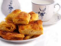 Homemade cheese strudel and cup of milk Stock Images