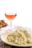Homemade Cheese, Wine and Walnuts. A nice plate of fresh homemade cheese on the table. A glass of rose' wine and some walnuts on the background royalty free stock photo