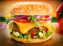 Homemade cheeseburger or burger on a sesame bun Royalty Free Stock Photography