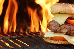 Homemade Cheeseburger Close-up On Flaming Barbecue Grill Backgro Royalty Free Stock Image