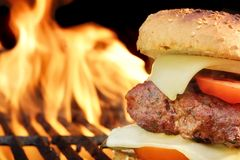 Free Homemade Cheeseburger Close-up On Flaming Barbecue Grill Background Royalty Free Stock Image - 53431026