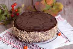 Homemade cheesecake with chocolate and nuts. On the desk Royalty Free Stock Photography
