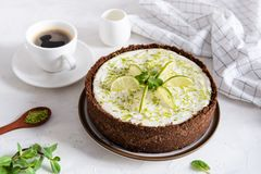 Homemade cheesecake with lime and mint for dessert - healthy organic summer dessert pie cheesecake. Cheese cake with a cup of stock photography