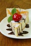 Homemade cheesecake with powdered sugar and cherry Stock Image