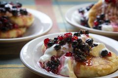 Homemade cheesecakes with sour cream and red and black currant s Royalty Free Stock Photo