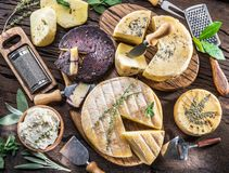Free Homemade Cheeses On The Wooden Background. Stock Images - 129419244