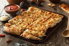Homemade Cheesy Breadsticks with Marinara Stock Photography