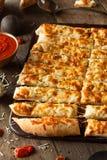 Homemade Cheesy Breadsticks with Marinara Royalty Free Stock Images