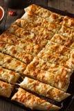Homemade Cheesy Breadsticks with Marinara Stock Image