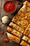 Homemade Cheesy Breadsticks with Marinara Stock Image