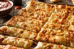 Homemade Cheesy Breadsticks with Marinara Royalty Free Stock Photos