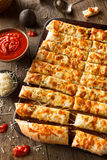 Homemade Cheesy Breadsticks with Marinara Stock Photos