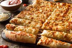 Homemade Cheesy Breadsticks with Marinara Stock Photography
