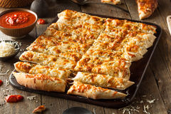 Homemade Cheesy Breadsticks With Marinara Royalty Free Stock Image