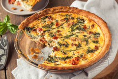 Homemade Cheesy Egg Quiche for Brunch. With Spinach and Tomato Royalty Free Stock Photos