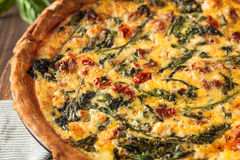 Homemade Cheesy Egg Quiche for Brunch. With Spinach and Tomato Royalty Free Stock Images