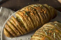 Homemade Cheesy Hasselback Potato Stock Images