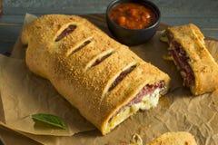 Homemade Cheesy and Meaty Italian Stromboli Royalty Free Stock Image
