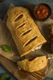 Homemade Cheesy and Meaty Italian Stromboli Royalty Free Stock Photography